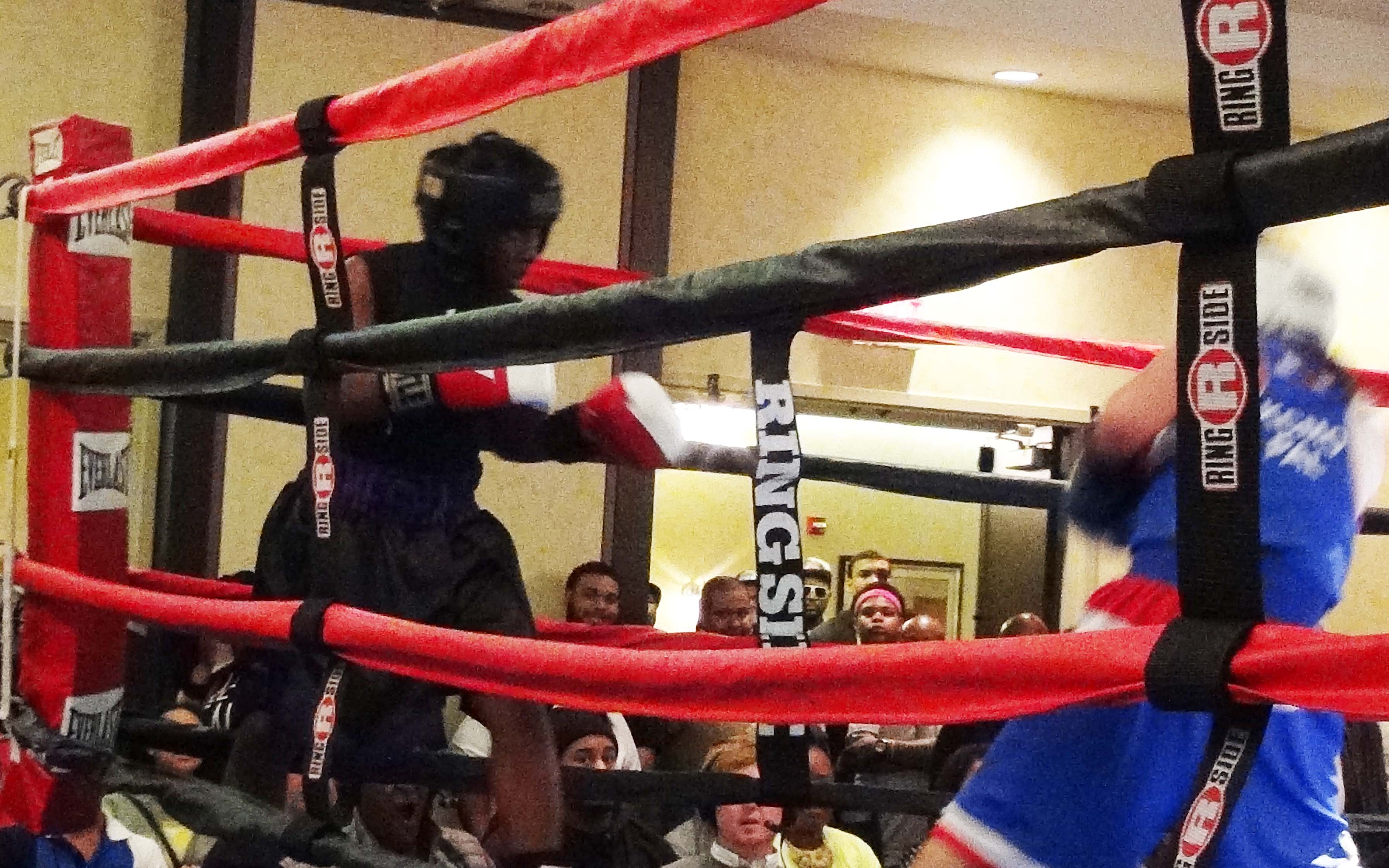 "Jermesha Poke being aggressive during her boxing match at ""saturday Night Fights,"" March 8, 2014 in St. Louis, Missouri. Photo by Lin. Woods @Copyright Lin. Woods 2014"