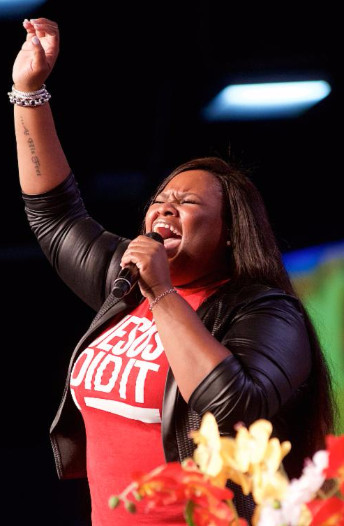 Tasha Cobbs perfors at the Long Beach Gospel Festival 2015 in Long Beach, CA.