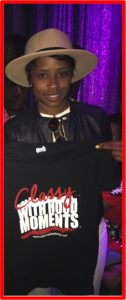 "Dej Loaf holding t-short ""Classy With Hood Moments"" by Adorned Clothing"