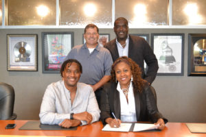 D3 Music Group executives sign with Provident Music Distribution.