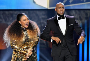 LAS VEGAS, NV - MARCH 25: Co-hosts Erica Campbell (L) and Anthony Brown speak onstage during the 32nd annual Stellar Gospel Music Awards at the Orleans Arena on March 25, 2017 in Las Vegas, Nevada.